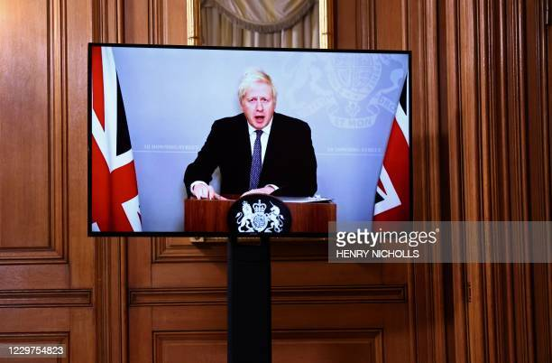 On screen due to selfisolating Britain's Prime Minister Boris Johnson holds a virtual press conference inside 10 Downing Street in central London on...