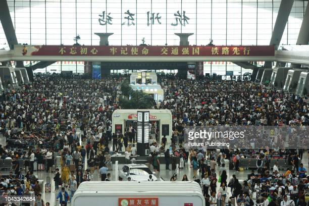 On September 30 passengers waiting at the waiting hall of Hangzhou east railway station in Zhejiang, China. The day before the National Day Golden...