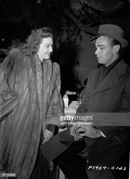 On set of 'And Now Tomorrow' directed by Irving Pichel for Paramount American actress Loretta Young chats with a taciturn Alan Ladd He also costarred...