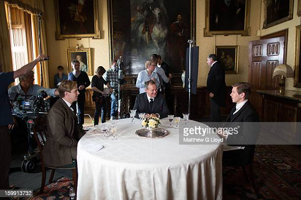 On set of Downton Abbey during production of series III with actors Dan Stevens Hugh Bonneville and Allen Leech photographed for the Los Angeles...