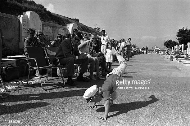 On set of 'La Piscine' directed by Jacques Deray In Saint Tropez France In August 1968 Alain Delon Romy Schneider and son David