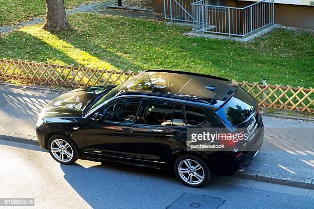 BMW SUV on sidewalk