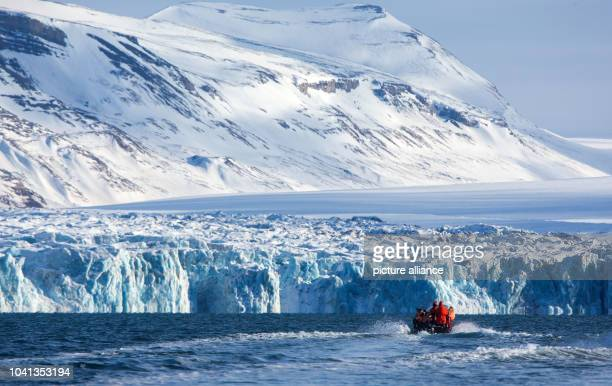 On small boats researchers of the Alfred Wegener Institute are on the way to the Kongsfjorden glaciers near the Kings Bay research stations in...