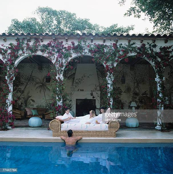 Melita Franzheim Pamela Mrs Whitney Tower Jr and Barbara Franzheim Dror by the pool at Franzheim Dror's house in Palm Beach Florida 1984