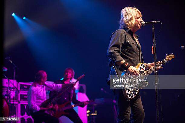 On stage during their show Rick Parfitt Francis Rossi background left and John Edwards of the band Status Quo play from their 90minute repertoire of...
