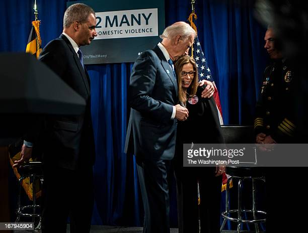 On stage Vice President Joe Biden holds Janet Blackburn, from Ellicott City who lost her sister, two nephews, and niece to domestic violence, after...