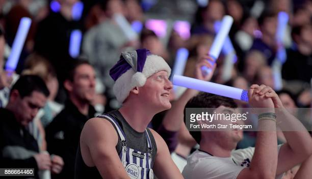 On StarWars theme night TCU Horned Frogs fans wave purple light sabers during the team introductions as TCU plays SMU in college basketball at...