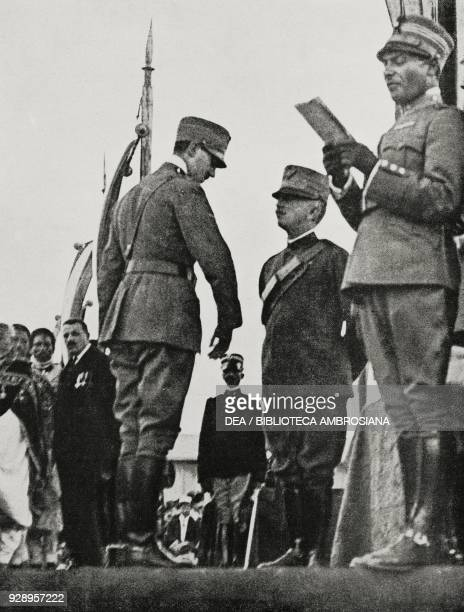 On Statute day King Victor Emmanuel III gives the medals to the value in presence of the Abyssinian mission Rome Italy from L'Illustrazione Italiana...