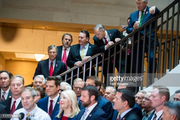 On steps from left Reps Brian Babin RTexas Doug LaMalfa DCalif Alex Mooney RWVa Andy Biggs RAriz and Rick Allen RGa attend a news conference in the...