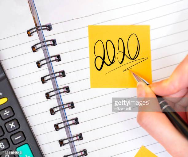 new year resolutions 2020 on sticky notes on a note - 2020 stock pictures, royalty-free photos & images