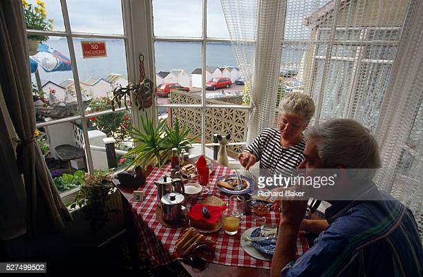 On table 3, a holiday couple enjoy a full English cooked breakfast in the bay window of a Bed & Breakfast in the Devon seaside resort of Paignton....