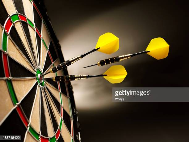on target in darts - possible stock pictures, royalty-free photos & images