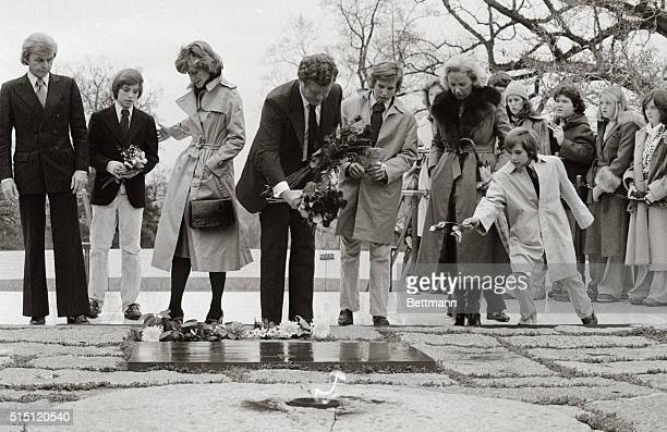 On the 14th anniversary of the assassination of John F Kennedy members of his family visit his grave in Arlington National Cemetery Left to right are...