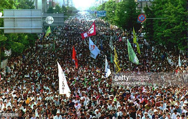 On the 14th anniversary of the Kwangju massacre thousands of people march through Kwangju 18 May 1994 as they remember the people killed by...