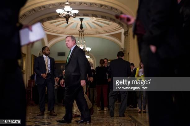 On the 15th day of a government shutdown with debt default looming Senator Dick Durbin walks onto the Senate floor after the Senate policy luncheon...