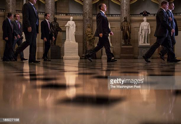 On the 16th day of a government shutdown with a debt default possible if a deal isn't struck Speaker of the House John Boehner walks to the House...