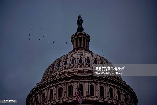 On the 16th day of a government shutdown with debt default hours away the sun rises on the US Capitol dome as a solution is still to be found...