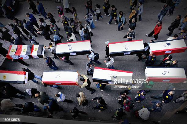 CONTENT] On the 2nd of December 2011 hundreds of Egyptian activists marched from Mostafa Mahmoud mosque to Tahrir square in a symbolic funeral for...