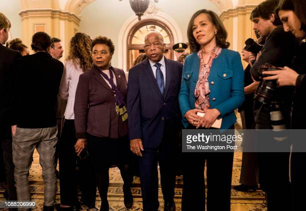 On the 34th day of the partial government shutdown member of Congress Rep Barbara Lee Rep John Lewis and Rep Lisa Blunt Rochester walk off the Senate...