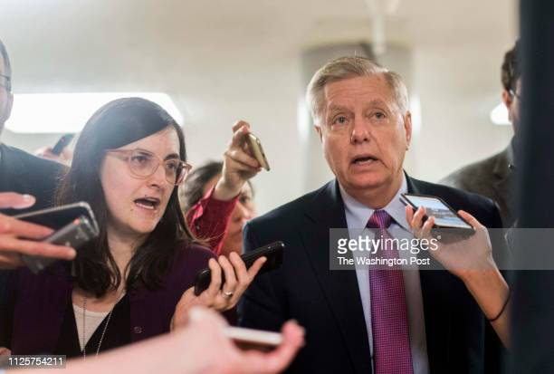 On the 34th day of the partial government shutdown Senator Lindsey Graham speaks to journalists while walking to the Senate floor for votes on...