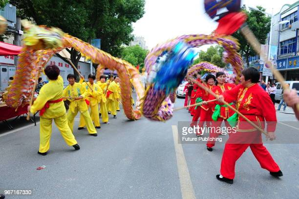 On the afternoon of June 4 more than a thousand farmers in shuangfeng town taicang city jiangsu province China walked on the street and danced dragon...