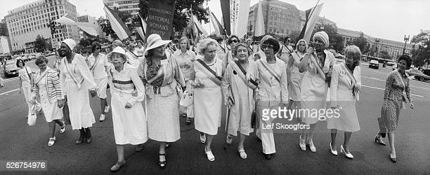On the anniversary of women's right to vote feminists march in support of the Equal Right Amendment in Washington DC