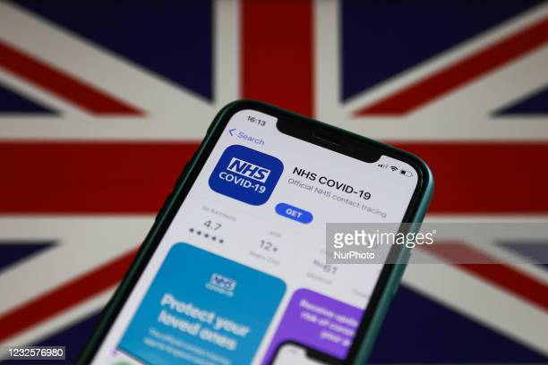 On the App Store is seen displayed on a phone screen with British flag in the background in this illustration photo taken in Krakow, Poland on April...