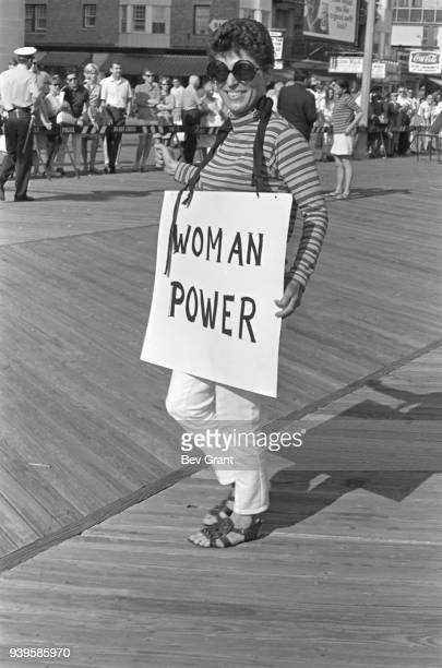 On the Atlantic City Boardwalk a demonstrator carries a poster that reads 'Woman Power' as she protests the Miss America beauty pageant Atlantic City...
