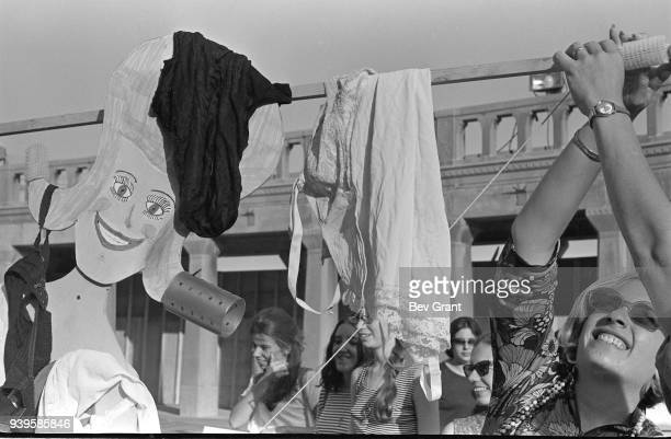 On the Atlantic City Boardwalk a demonstrator holds up a Miss America marionette draped in underwear high heels and hair curlers during a protest of...