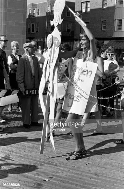 On the Atlantic City Boardwalk a demonstrator operates a marionette as she protests the Miss America beauty pageant Atlantic City New Jersey...