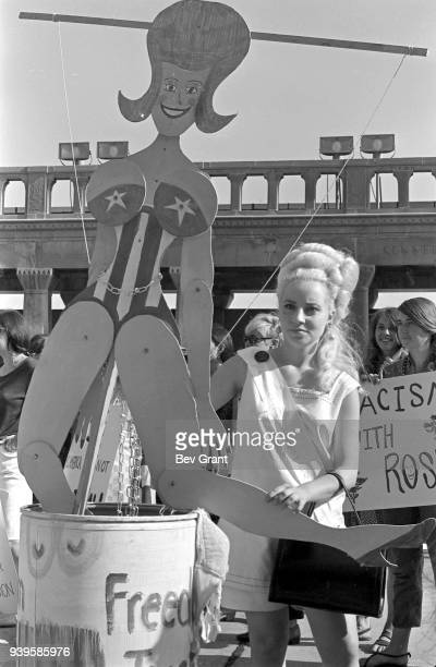 On the Atlantic City Boardwalk, a demonstrator stands beside a Miss America marionette in the 'Freedom Trash Can' during a protest against the Miss...