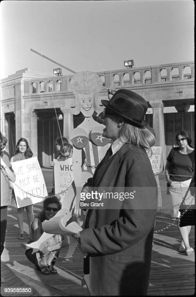 On the Atlantic City Boardwalk demonstrator Peggy Dobbins 'auctions' a chained marionette during a protest of the Miss America beauty pageant...