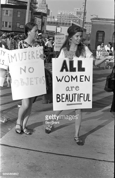 On the Atlantic City Boardwalk, demonstrators carry posters as they protest the Miss America beauty pageant, Atlantic City, New Jersey, September 7,...