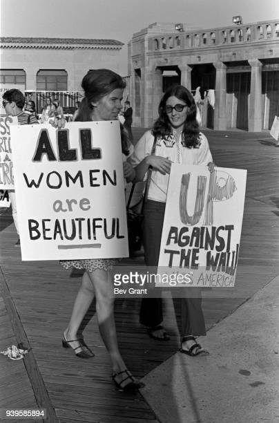On the Atlantic City Boardwalk demonstrators carry posters as they protest the Miss America beauty pageant Atlantic City New Jersey September 7 1968...