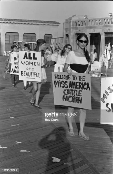 On the Atlantic City Boardwalk, demonstrators, many with posters, protest the Miss America beauty pageant, Atlantic City, New Jersey, September 7,...