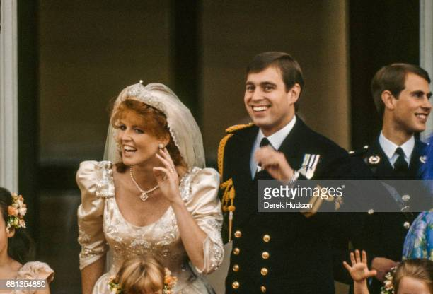 On the balcony of Buckingham Palace Sarah Duchess of York and Prince Andrew Duke of York wave to wellwishers after their wedding London England July...