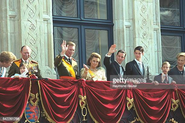 On the balcony of GrandDucal Palace from left Grand Duchess Jos{phine Charlotte Grand Duke Jean Princess Alexandra Prince HenriPrincess Maria Teresa...