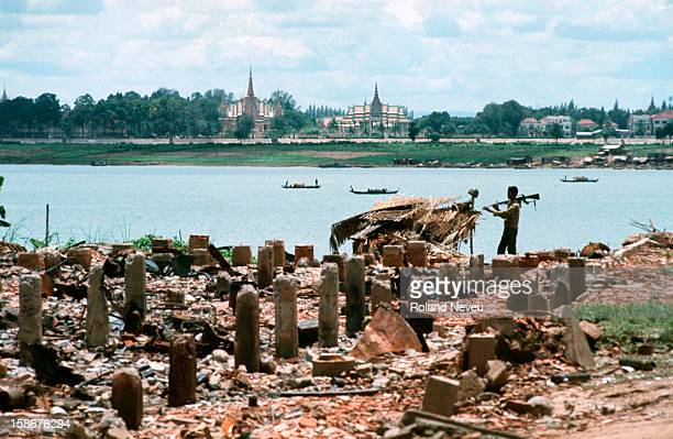 On the bank of the Tonle Sap river opposite the Royal Palace fierce fighting and heavy bombing have left nothing standing