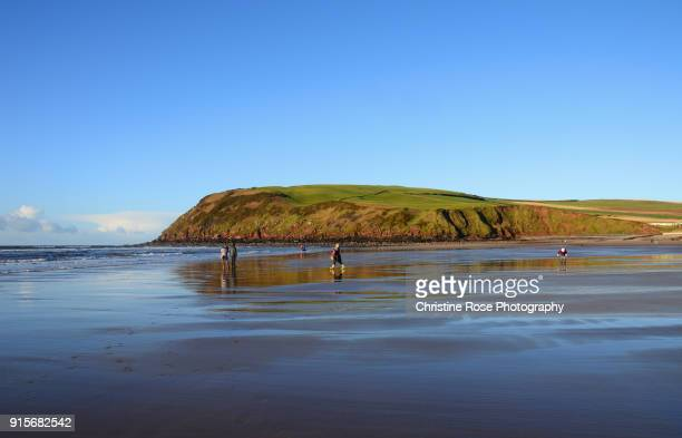 on the beach in december - irish sea stock pictures, royalty-free photos & images