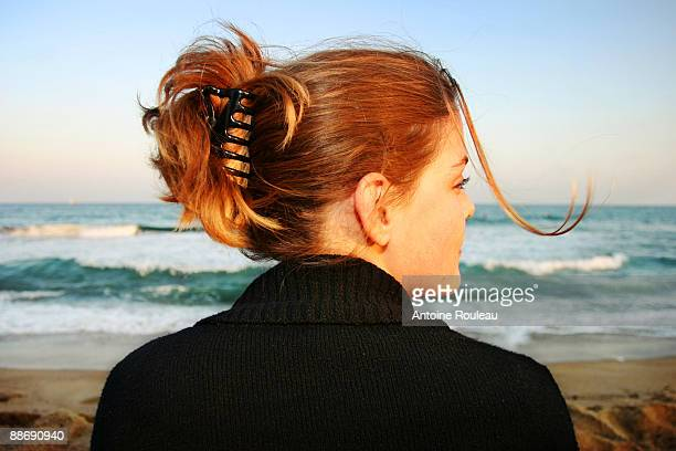 on the beach - hair clip stock pictures, royalty-free photos & images
