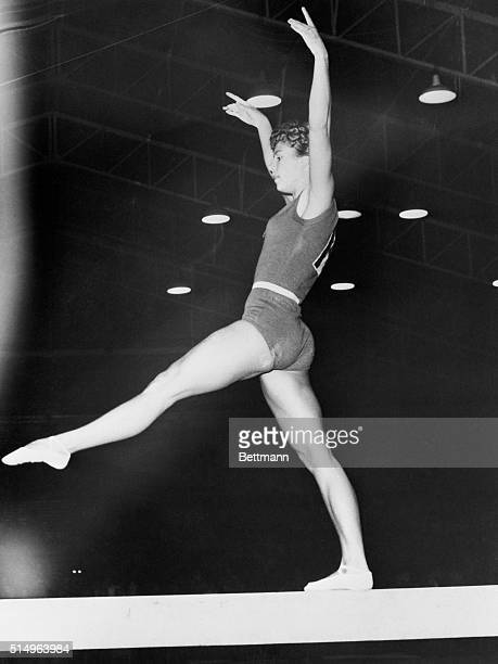 On the Beam Melbourne Australia Russian female gymnast Larissa Latynina balances on a beam during Olympic Gymnastic event here She captured first...