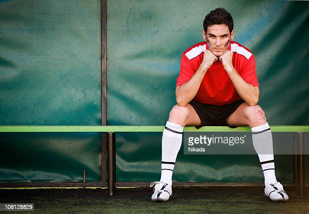 on the bench - soccer player stock pictures, royalty-free photos & images