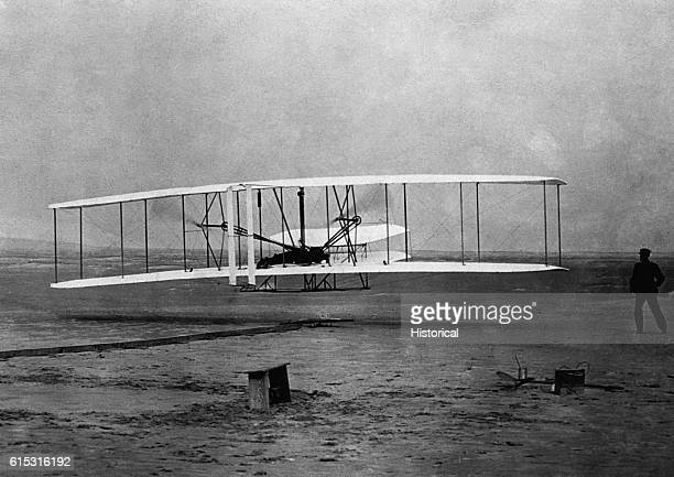 On the bleak sands of Kitty Hawk, the Wrights make their historic first heavier-than-air flight.