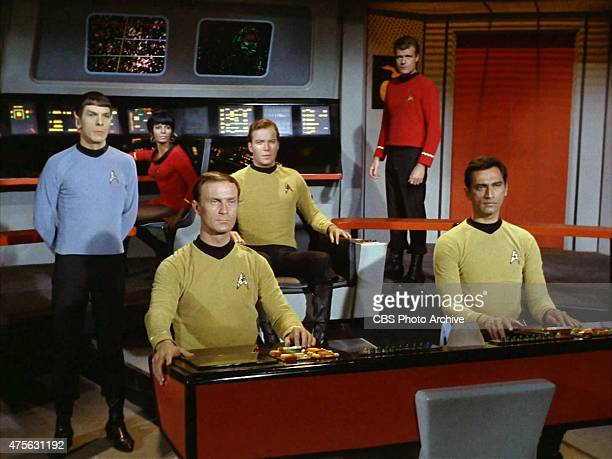 On the bridge of the USS Enterprise from left Leonard Nimoy as Commander Spock Nichelle Nichols as Lt Uhura William Blackburn as Lt Hadley William...