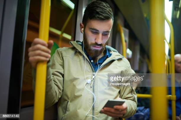 on the bus with a few good tunes - one man only stock pictures, royalty-free photos & images