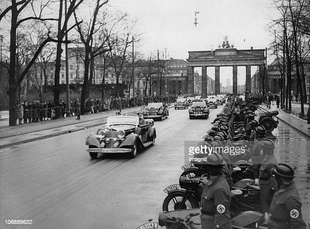 On the Charlottenburg Chaussee lined with NSKKsoldiers Adolf Hitler drives to the exhibtion center on the occasion of the opening of the...
