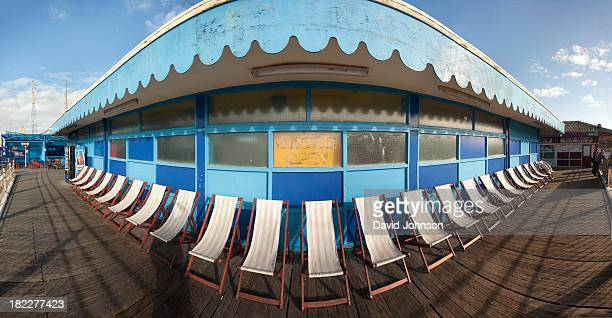 On the coast at Blackpool. This is a wide angle panorama of empty deck chairs left out at the end of the summer season.