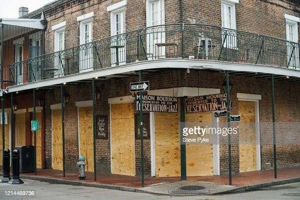 On the corner of Bourbon and St Peter Street the Maison Bourbon Jazz Club in the French Quarter of New Orleans is boarded up amid restrictions in...