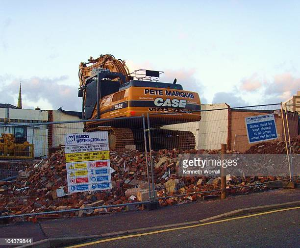 On the corner of Corporation Street, Preston,Lancashire, England, UK. Features a digger knocking down old council flats to make way for student...