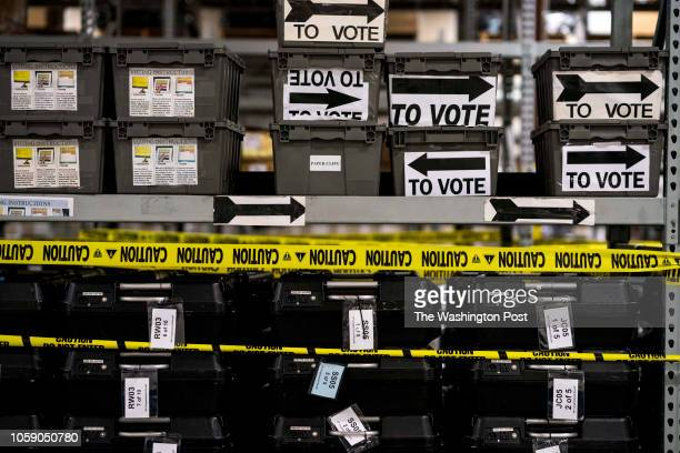 ATLANTA GEORGIA On the day after election day in Georgia shelves and shelves of sequestered voting machines wrapped with yellow caution tape still...